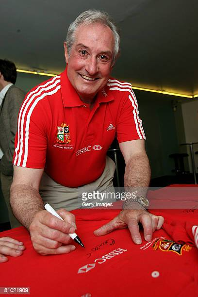 Lions Tour Ambassador Gareth Edwards signs a shirt prior to taking part in a debate on May 7 2008 at Tate Britain in London England