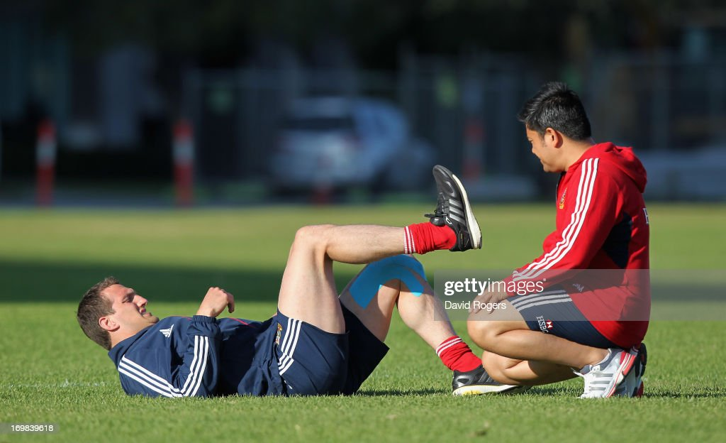 Lions tour captain Sam Warburton receives attention to his injured left leg from physiotherapist Prav Mathema during the British and Irish Lions training session held at Langley Park on June 3, 2013 in Perth, Western Australia.