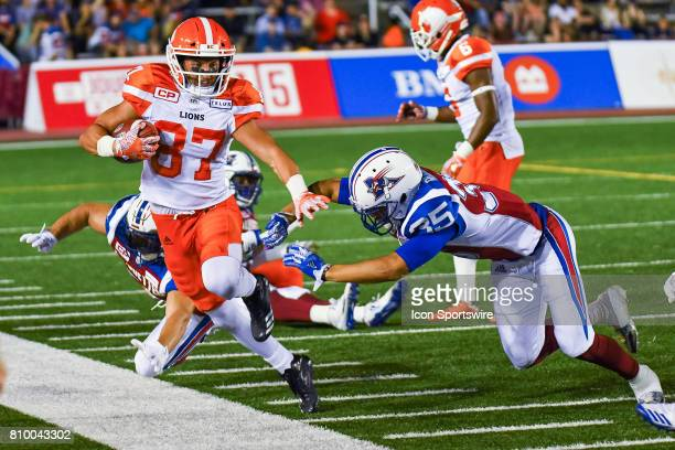 Lions wide receiver Marco Iannuzzi avoiding contach with Montreal Alouettes defensive back Jalen Rogers on the sideline during the BC Lions versus...