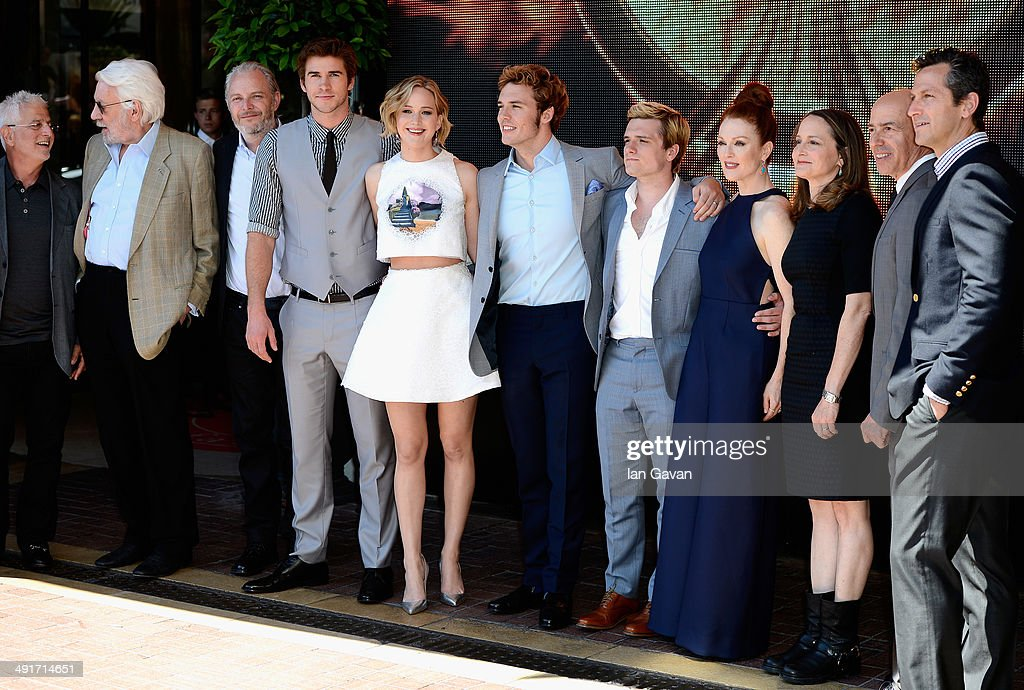 Lionsgate Motion Picture Group Co-Chairman Rob Friedman, actor Donald Sutherland, director Francis Lawrence, actors Liam Hemsworth, Jennifer Lawrence, Sam Claflin, Josh Hutcherson, Julianne Moore, producers Nina Jacobson, Jon Kilik and Lionsgate President of Production Erik Feig attend 'The Hunger Games: Mockingjay Part 1' photocall at the 67th Annual Cannes Film Festival on May 17, 2014 in Cannes, France.