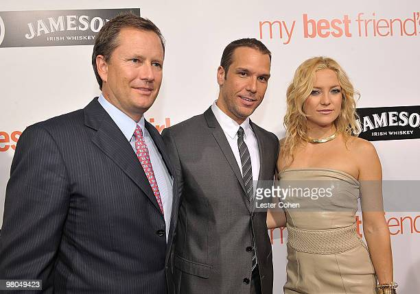 Lionsgate Vice Chairman Michael Burns actor Dane Cook and actress Kate Hudsonarrive on the red carpet of the world premiere of My Best Friend's Girl...