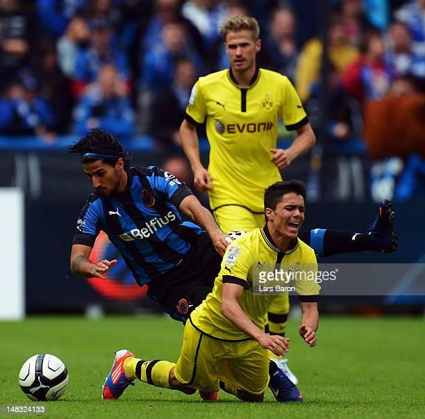 Lior Rafaelov of Brugge challenges Leonardo Bittencourt of Dortmund during a friendly match between Club Brugge KV and Borussia Dortmund at Jan...