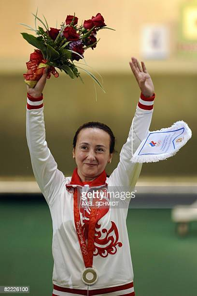 Lioubov Galkina of Russia celebrates after winning the silver medal in the women's 10m Air Rifle competition of the 2008 Beijing Olympic Games on...