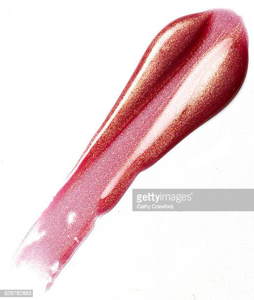 lip gloss smear, red and gold