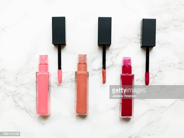 Lip glosses on marble background