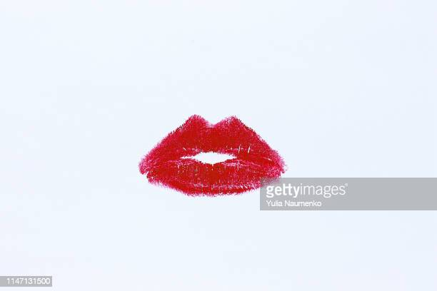 lip imprint with red lipstick on white background - lipstick stock pictures, royalty-free photos & images