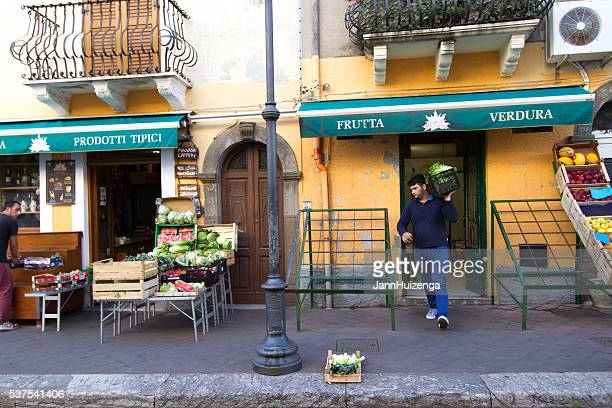 Lipari, Sicily: Stocking an Outdoor Fruit and Vegetable Display