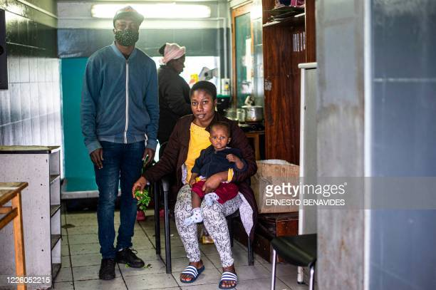 Liphete Vixamar pose for a picture with his wife Kaline Noel and their baby at a bus station in Lima on July 10 2020 On March 16 2020 the order of...