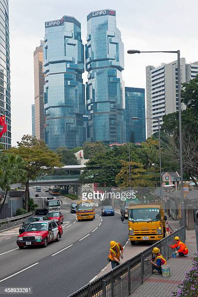 lippo centre and workers in hong kong - pavliha stock photos and pictures