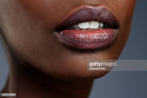 lips. close up. beauty, fashion portrait. beautiful, lovely and sensual young african girl. gray wall background. - human lips stock pictures, royalty-free photos & images