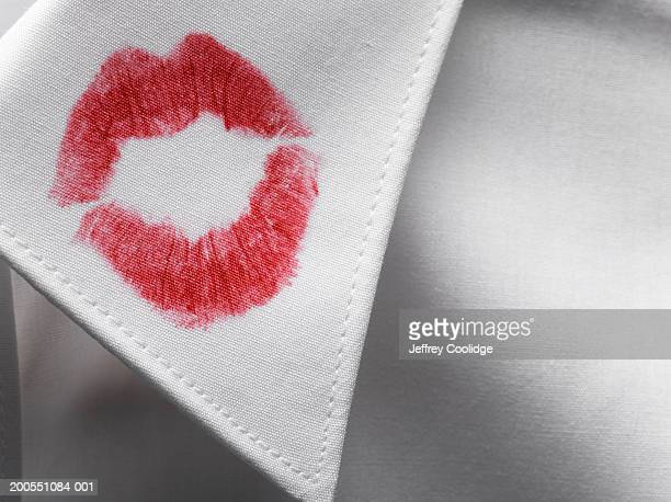 Lipstick kiss stain on shirt collar, close-up