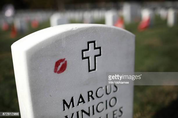 Lipstick marks the headstone of US Army Sgt First Class Marcus Vinicio Muralles at Arlington National Cemetery on Veterans Day November 11 2017 in...