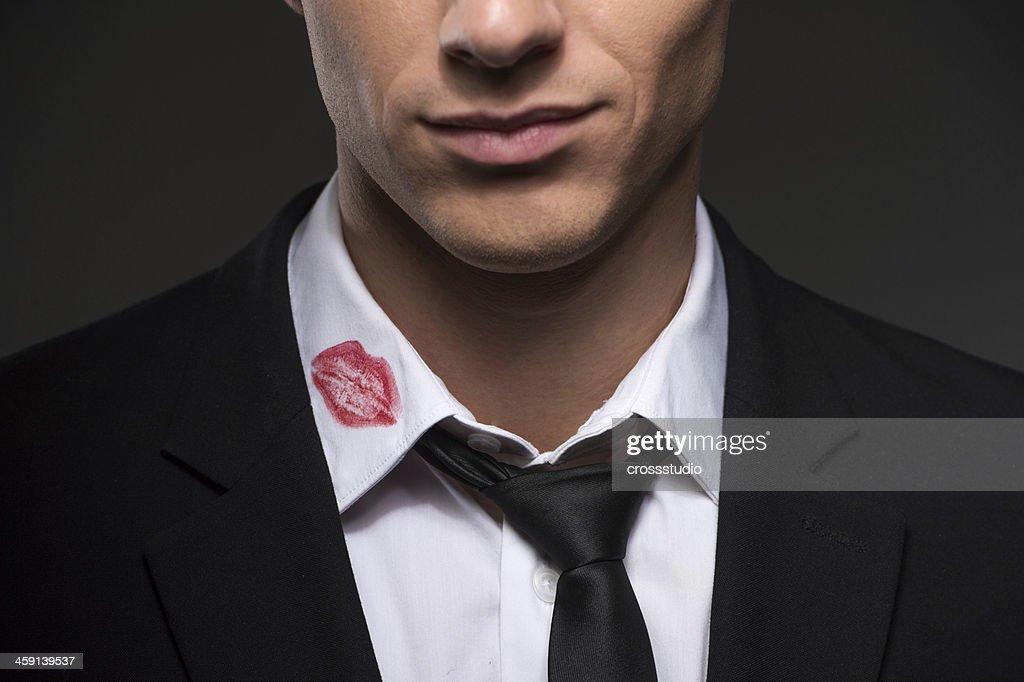 Lipstick on your collar. : Stock Photo