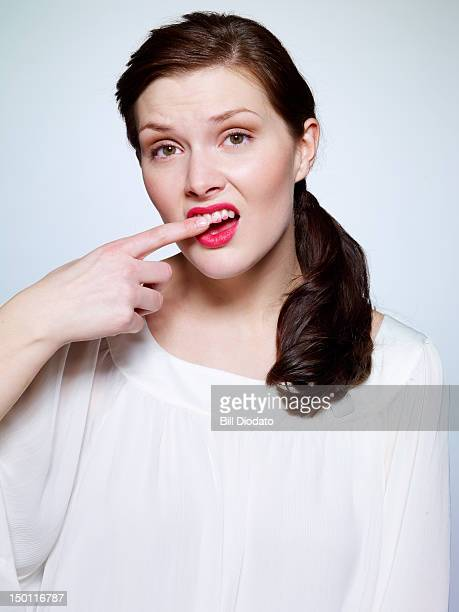 lipstick teeth - bad teeth stock photos and pictures