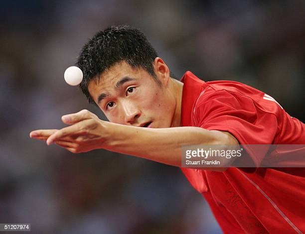 Liqin Wang of China serves during the men's singles table tennis gold medal match against Jan-Ove Waldner of Sweden on August 23, 2004 during the...