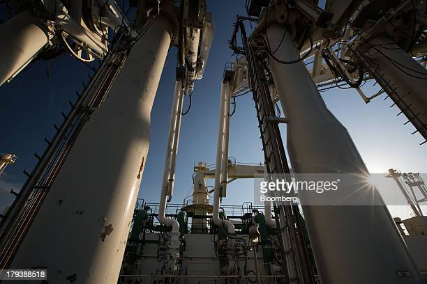 Liquefied natural gas is unloaded via pipes from the Al Kharsaah LNG tanker docked at the Korea Gas Corp LNG terminal in Pyeongtaek South Korea on...