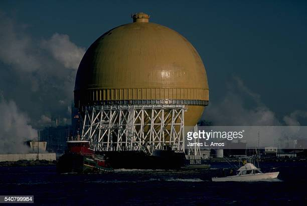 A liquefied natural gas tank dwarfs the tugboat towing it Such tanks are the largest aluminum manufactured product Copper River near Charleston South...