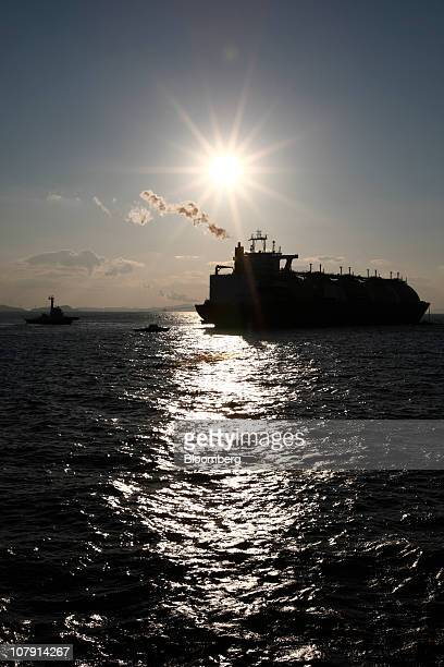 A liquefied natural gas tanker is silhouetted by the sun while anchored at a port in Incheon South Korea on Thursday Jan 6 2011 Liquefied natural gas...