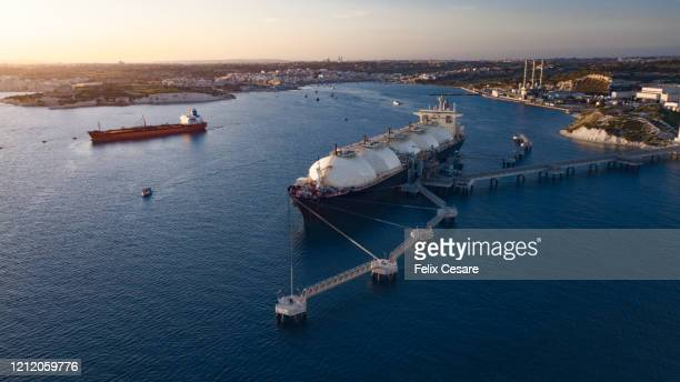 liquefied natural gas (lng) tanker moored to the jetty - storage tank stock pictures, royalty-free photos & images