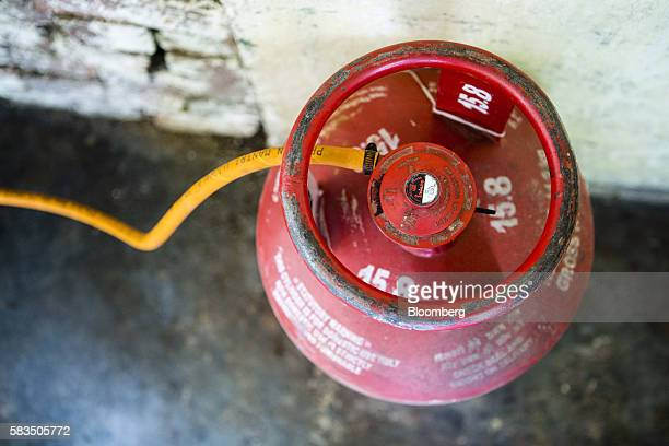 A liquefied petroleum gas cylinder stands connected to a stove in the home of housewife Rita Sharma in the village of Mangrauli Uttar Pradesh India...