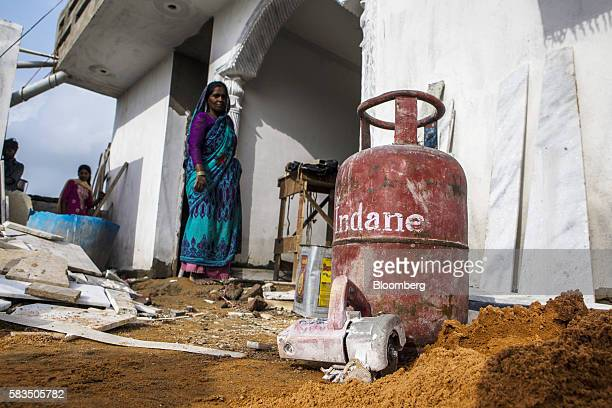 A liquefied petroleum gas cylinder stands outside a house under construction in the village of Mangrauli Uttar Pradesh India on Tuesday July 19 2016...
