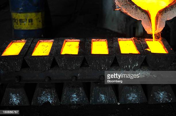 Liquid brass a mixture of copper and zinc is poured into moulds in the foundry at the copper mining and smelting complex operated by RBT Bor Group in...
