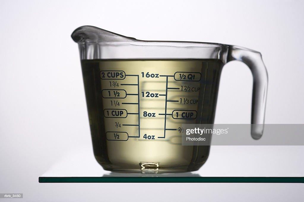 Liquid in a measuring jug : Stock Photo