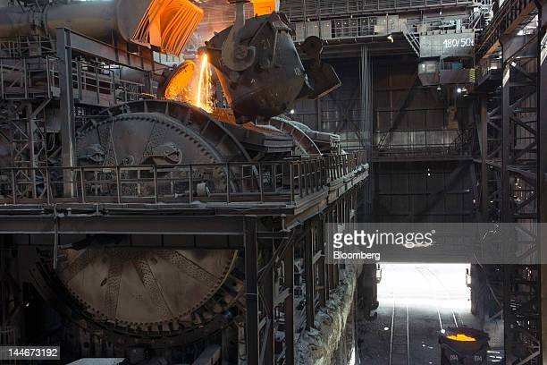 Liquid metal is poured from crucibles into a drum at the ArcelorMittal steelmaking factory in Kryvyi Rih Ukraine on Thursday May 17 2012...