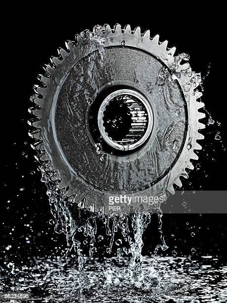 Liquid / oil dripping from large steel gear / cog