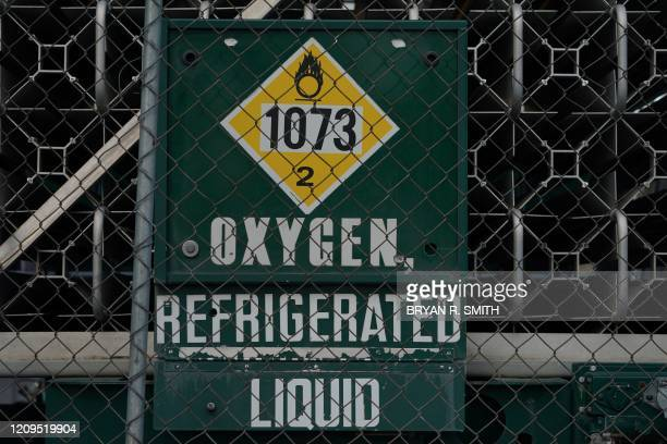 Liquid oxygen tank is parked outside a temporary field hospital for COVID-19 patients under construction at the USTA Billie Jean King national tennis...