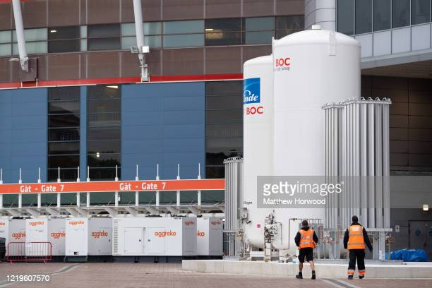 Liquid oxygen tanks are installed for the Dragon's Heart hospital, a 2000-bed coronavirus field hospital situated within the Principality Stadium, on...