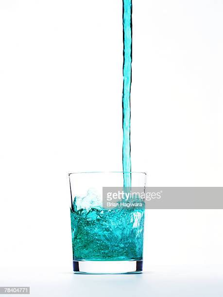 liquid pouring into glass - mouthwash stock pictures, royalty-free photos & images