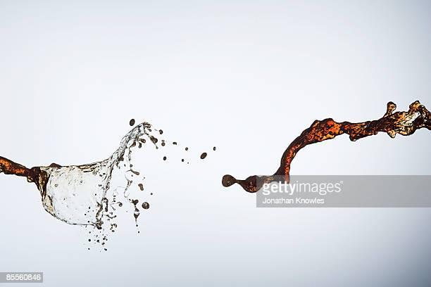 Liquid sprayed against white background