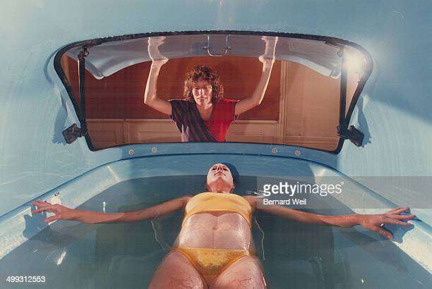 Liquid therapy Julie Trip relaxes in a tank of Epsom salt solution while Elizabeth Randell gently closes the lid at Tranquility Tanks Ltd