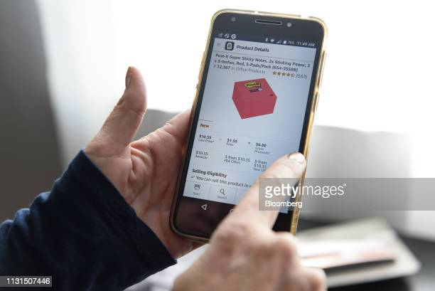 A liquidation reseller views the Amazoncom application on an Apple Inc iPhone in Napa California US on Friday March 11 2019 As overwhelmed retailers...