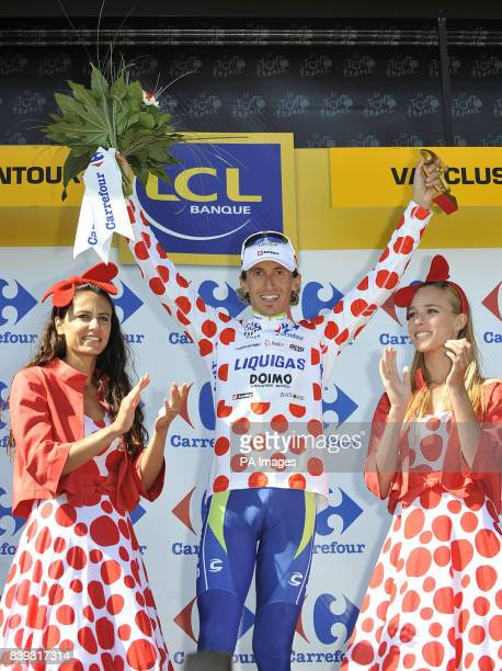 Liquigas's Franco Pellizotti on the podium to collect the polka dot 'King of the Mountains' jersey after the twentieth stage during the Twentieth...