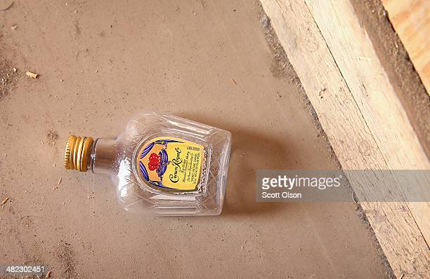 A liquor bottle sits on the floor of an abandoned building in an area that was once a heavily populated location on Forward Operating Base Shank on...