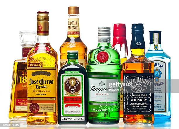 liquor bottles on a white background - fles stockfoto's en -beelden