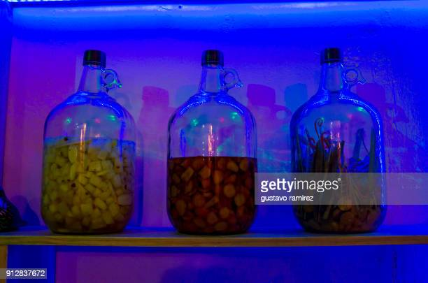 liquor bottles on bar shelf - event icon set stock photos and pictures