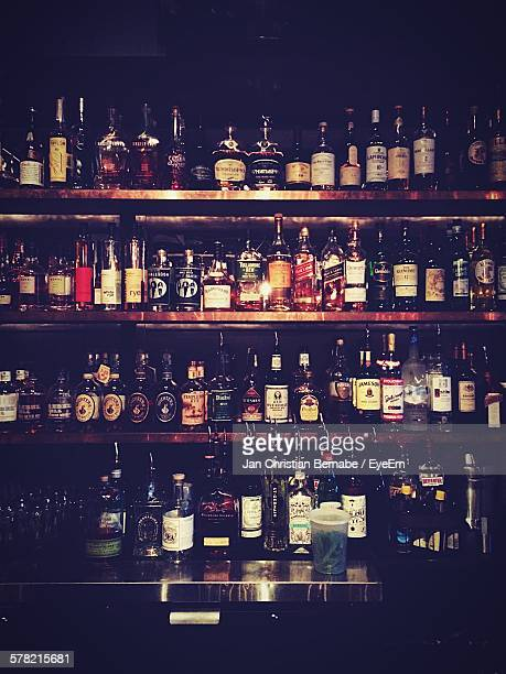 Liquor Bottles On Shelf In Bar