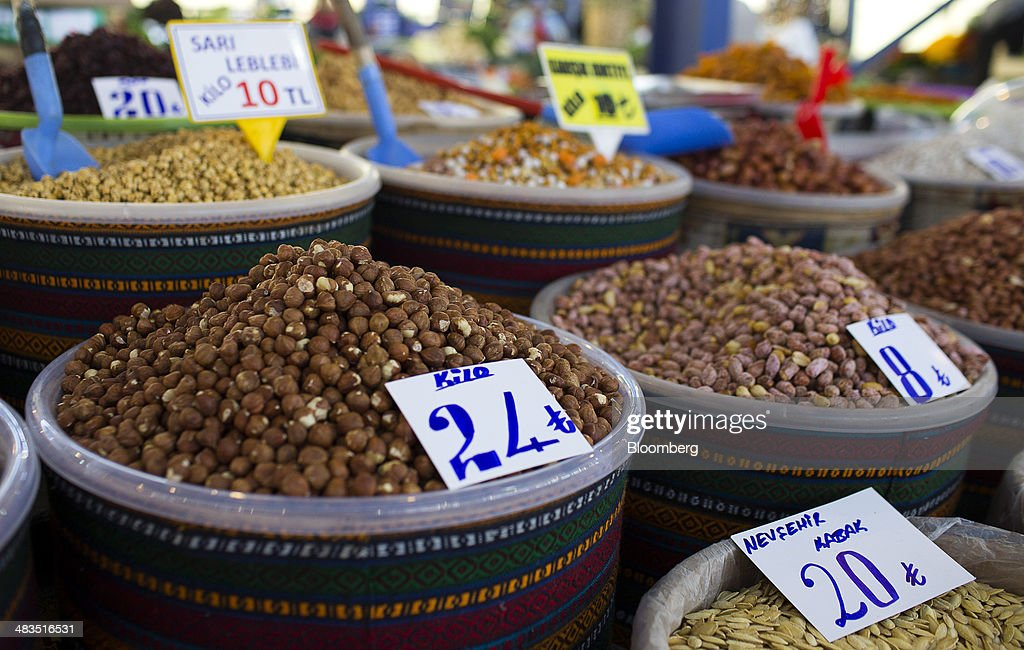 Lira price signs sit on tubs of nuts for sale at a stall in the Yesilkoy street market in Istanbul, Turkey, on Wednesday, April 9, 2014. Turkish central bank Governor Erdem Basci indicated to analysts in London on April 3 that he planned to keep monetary policy tight to control inflation. Photographer: Kerim Okten/Bloomberg via Getty Images