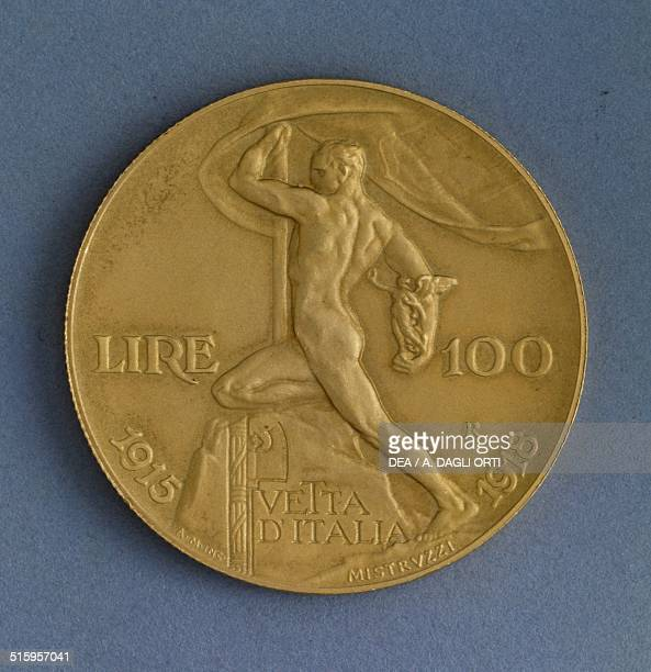 100 lire gold coin also known as Vetta d'Italia celebrating the 25 years of the reign of Victor Emmanuel IIII reverse male figure holding a flag and...