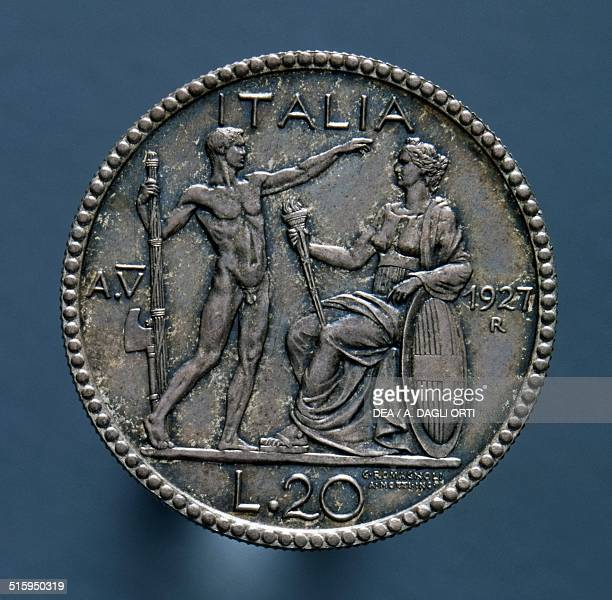 20 lire silver coin reverse lictor with fasces greets a seated woman Italy 20th century