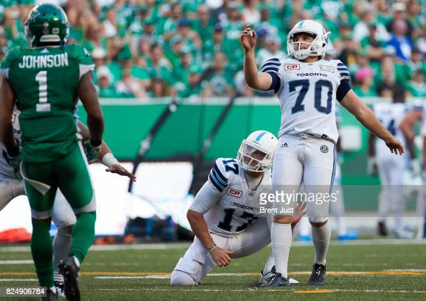 Lirim Hajrullahu and Cody Fajardo of the Toronto Argonauts watch the ball go through the uprights for a field goal in the game between the Toronto...