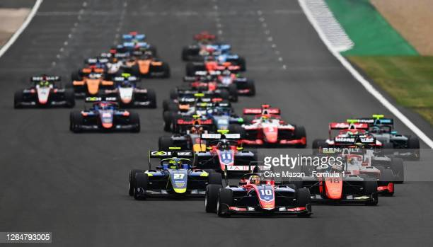 Lirim Zendeli of Germany and Trident leads Bent Viscaal of the Netherlands and MP Motorsport , Ben Barnicoat of Great Britain and Carlin Buzz Racing...