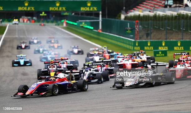 Lirim Zendeli of Germany and Trident leads Theo Pourchaire of France and ART Grand Prix and the field into turn one at the start during the first...