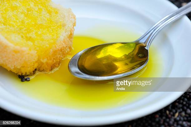 rapeseed oil on a slice of bread and seeds Colza is cultivated for the production of cooking oil and agrochemistry