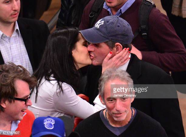 Lis Smith and Eliot Spitzer attend the Dallas Mavericks vs New York Knicks game at Madison Square Garden on February 24 2014 in New York City