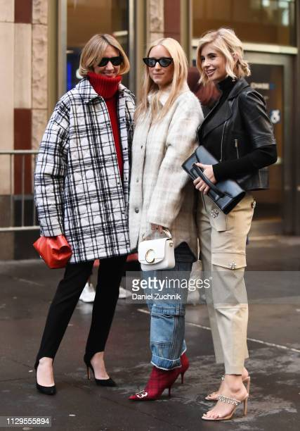Lisa Aiken, Charlotte Groeneveld and Xenia Adonts are seen outside the Michael Kors show during New York Fashion Week: Fall/Winter 2019 on February...