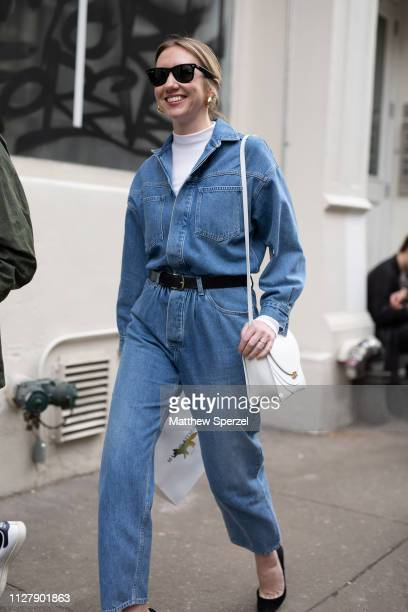 Lisa Aiken is seen on the street attending Bode during Men's Fashion Week New York wearing denim jumpsuit with white turtleneck and black belt with...